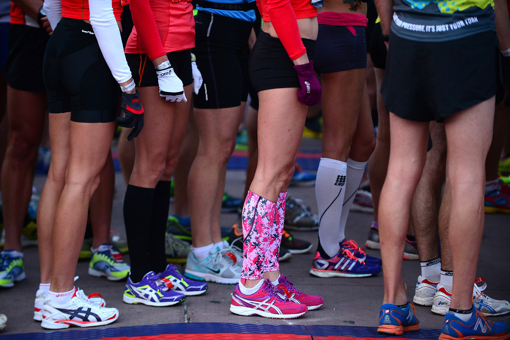 . Racers, with their brightly colored shoes, socks, shorts and shirts, line up for the start of the 4th annual Rock \'N\' Roll Marathon and 1/2 Marathon sponsored by Sports Authority in Denver, Co on October 20, 2013.  More than 15,000 participants and thousands of spectators, family and friends took part in the festivities that started and ended in Civic Center park. (Photo By Helen H. Richardson/ The Denver Post)