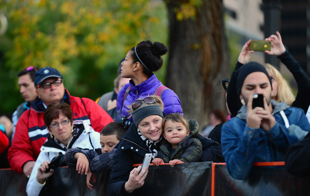. Jamie Valdez, with her sons Caden, 7, left and Ethan, 4 right, waits to get pictures of her husband Steve as he takes partin the 4th annual Rock \'N\' Roll Marathon and 1/2 Marathon sponsored by Sports Authority in Denver, Co on October 20, 2013.  More than 15,000 participants and thousands of spectators, family and friends took part in the festivities that started and ended in Civic Center park. (Photo By Helen H. Richardson/ The Denver Post)