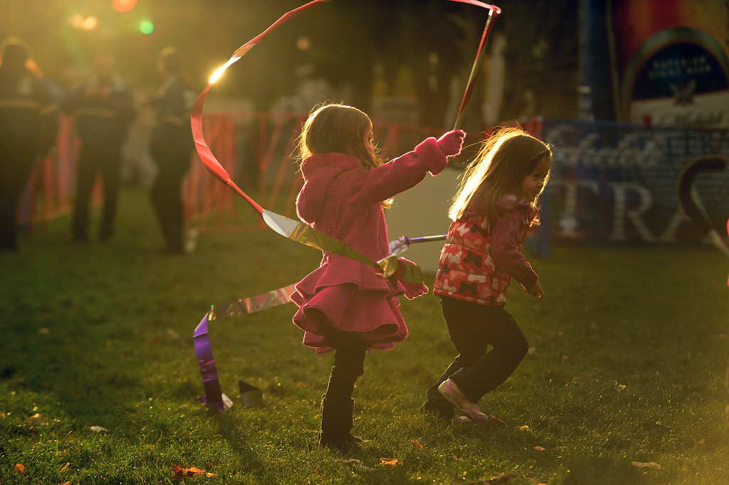 . Snodyn Steves, 4, middle and her cousin Maya Kraft, 4, right, of Thornton, play with ribbons in Civic Center park  in Denver, Co on October 20, 2013 while they wait for family members to finish the race.  They were taking part in the 4th annual Rock \'N\' Roll Marathon and 1/2 Marathon sponsored by Sports Authority in Denver, Co on October 20, 2013.  More than 15,000 participants and thousands of spectators, family and friends took part in the festivities that started and ended in Civic Center park. (Photo By Helen H. Richardson/ The Denver Post)