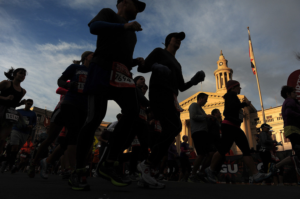 . Racers take off at the start of the 4th annual Rock \'N\' Roll Marathon and 1/2 Marathon sponsored by Sports Authority in Denver, Co on October 20, 2013 as they run by the City and County Building.  More than 15,000 participants and thousands of spectators, family and friends took part in the festivities that started and ended in Civic Center park. (Photo By Helen H. Richardson/ The Denver Post)