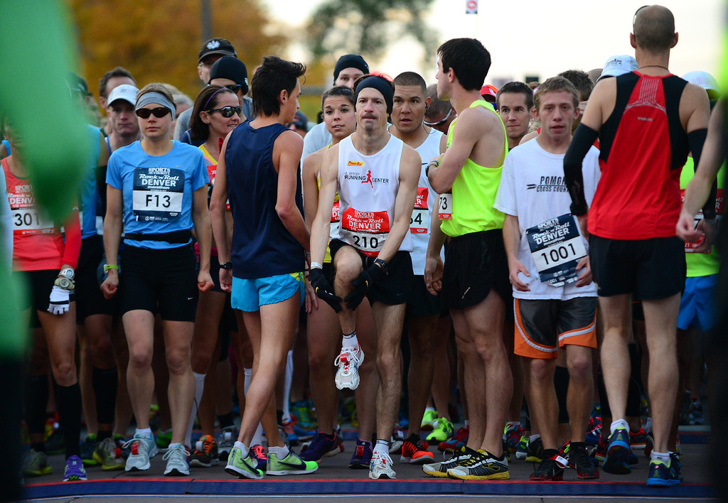 . Racers stretch before the start of the 4th annual Rock \'N\' Roll Marathon and 1/2 Marathon sponsored by Sports Authority in Denver, Co on October 20, 2013.  More than 15,000 participants and thousands of spectators, family and friends took part in the festivities that started and ended in Civic Center park. (Photo By Helen H. Richardson/ The Denver Post)