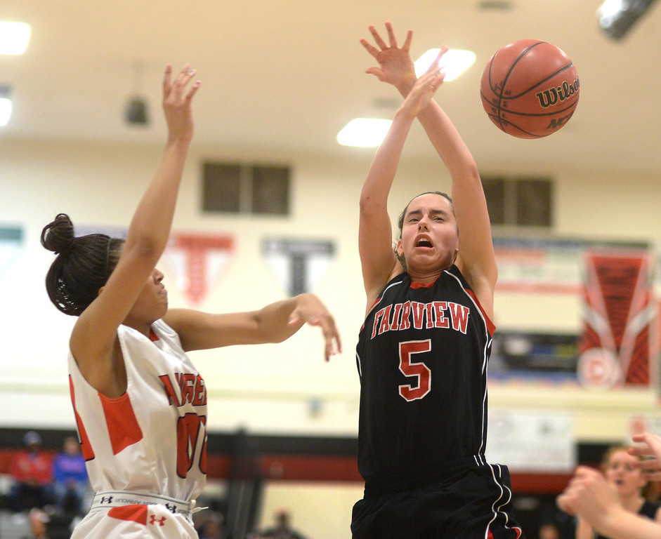 . Angels\' senior Rhian Finley-Ponds (00) knocked the ball away from Fairview forward Annika Lai (5) in the second half. The Denver East High School girl\'s basketball team defeated Fairview 68-53 Friday night, February 28, 2014. Photo By Karl Gehring/The Denver Post