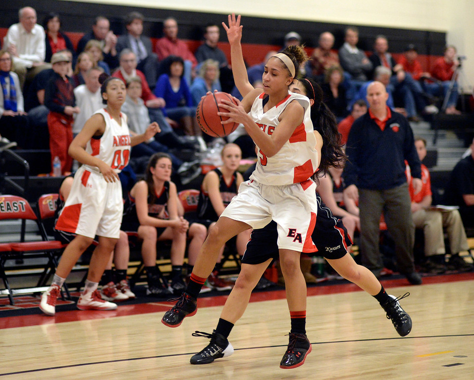 . East senior guard Michelle Cox (3) handled an inbound pass in the second half. The Denver East High School girl\'s basketball team defeated Fairview 68-53 Friday night, February 28, 2014. Photo By Karl Gehring/The Denver Post