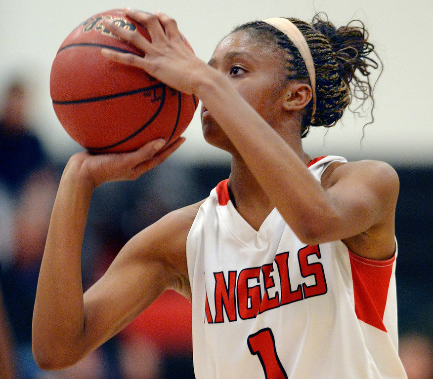 . Angels senior guard Ke\'Avae\' Taylor concentrated at the could line late in the fourth quarter. The Denver East High School girl\'s basketball team defeated Fairview 68-53 Friday night, February 28, 2014. Photo By Karl Gehring/The Denver Post