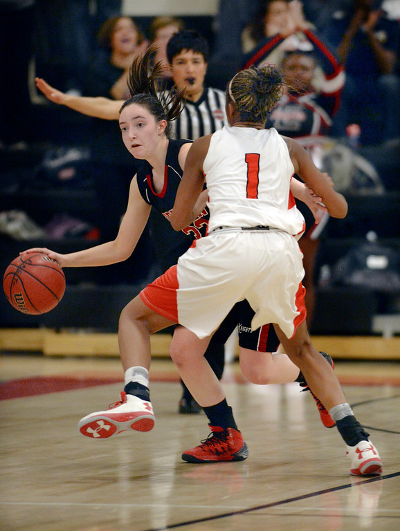 . Fairview senior guard Sarah Kaufmann (33) tried to get past East defender Ke\'Avae\' Taylor (1) in the second half. The Denver East High School girl\'s basketball team defeated Fairview 68-53 Friday night, February 28, 2014. Photo By Karl Gehring/The Denver Post