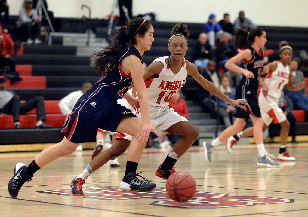 . Fairview sophomore guard Sarah Gordon (15) brought the ball up the court guarded by East junior Damajahnee Birch (10). The Denver East High School girl\'s basketball team defeated Fairview 68-53 Friday night, February 28, 2014. Photo By Karl Gehring/The Denver Post