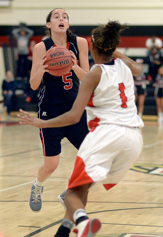 . Fairview junior Annika Lai (5) looked for room to work around East guard Ke\'Avae\' Taylor (1) in the second half. The Denver East High School girl\'s basketball team defeated Fairview 68-53 Friday night, February 28, 2014. Photo By Karl Gehring/The Denver Post