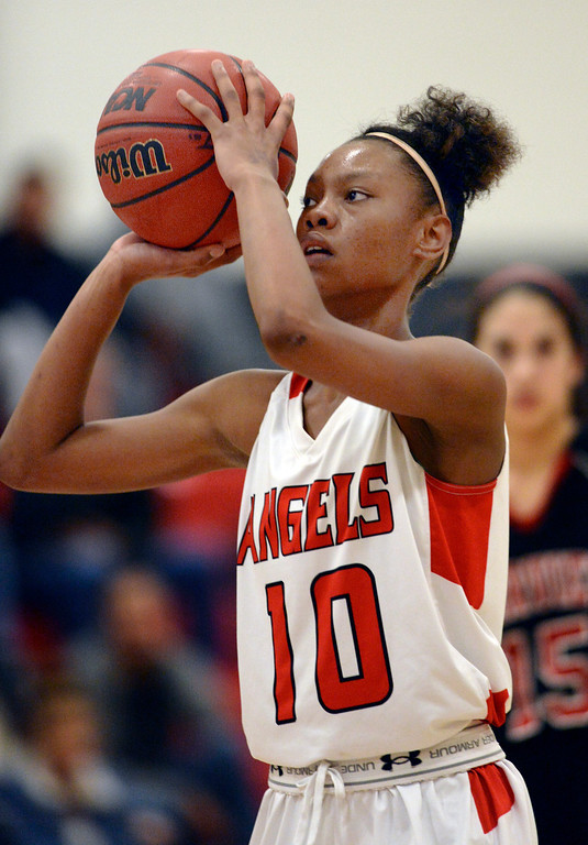 . East junior forward Damajahnee  Birch (10) shot from the line late in the fourth quarter. The Denver East High School girl\'s basketball team defeated Fairview 68-53 Friday night, February 28, 2014. Photo By Karl Gehring/The Denver Post