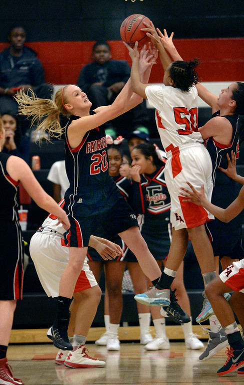 . Fairview center Madi Wolf (20) battled for a rebound with East Raeyanna Culbreath (50) in the second half. The Denver East High School girl\'s basketball team defeated Fairview 68-53 Friday night, February 28, 2014. Photo By Karl Gehring/The Denver Post