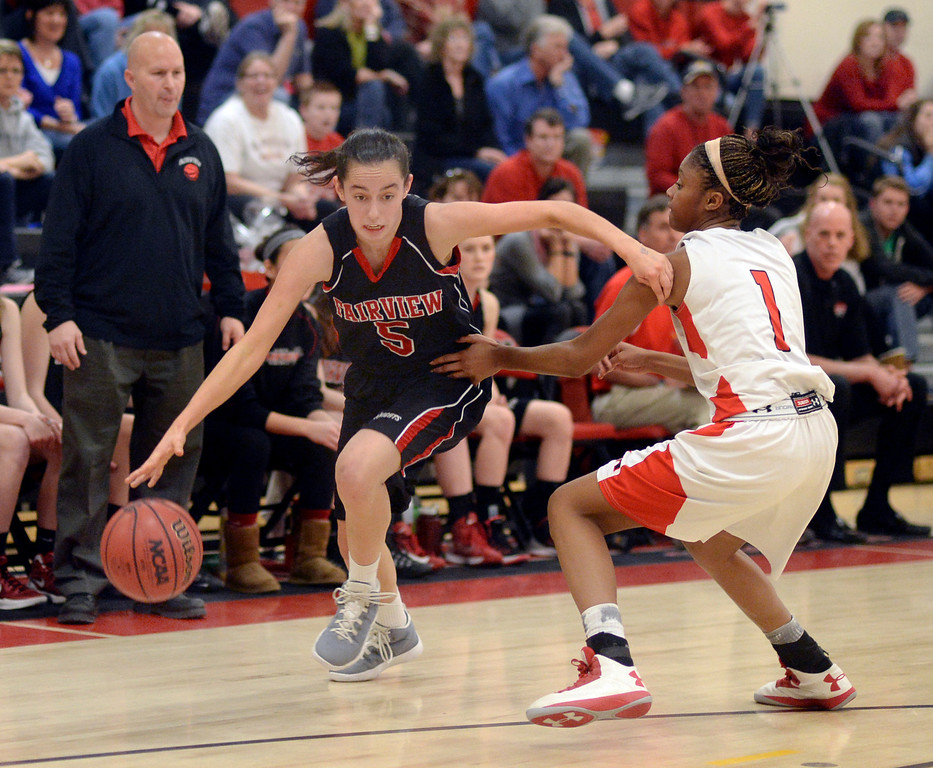 . Fairview guard Annika Lai (5) tried to get past East defender Ke\'Avae\' Taylor (1) in the second half. The Denver East High School girl\'s basketball team defeated Fairview 68-53 Friday night, February 28, 2014. Photo By Karl Gehring/The Denver Post