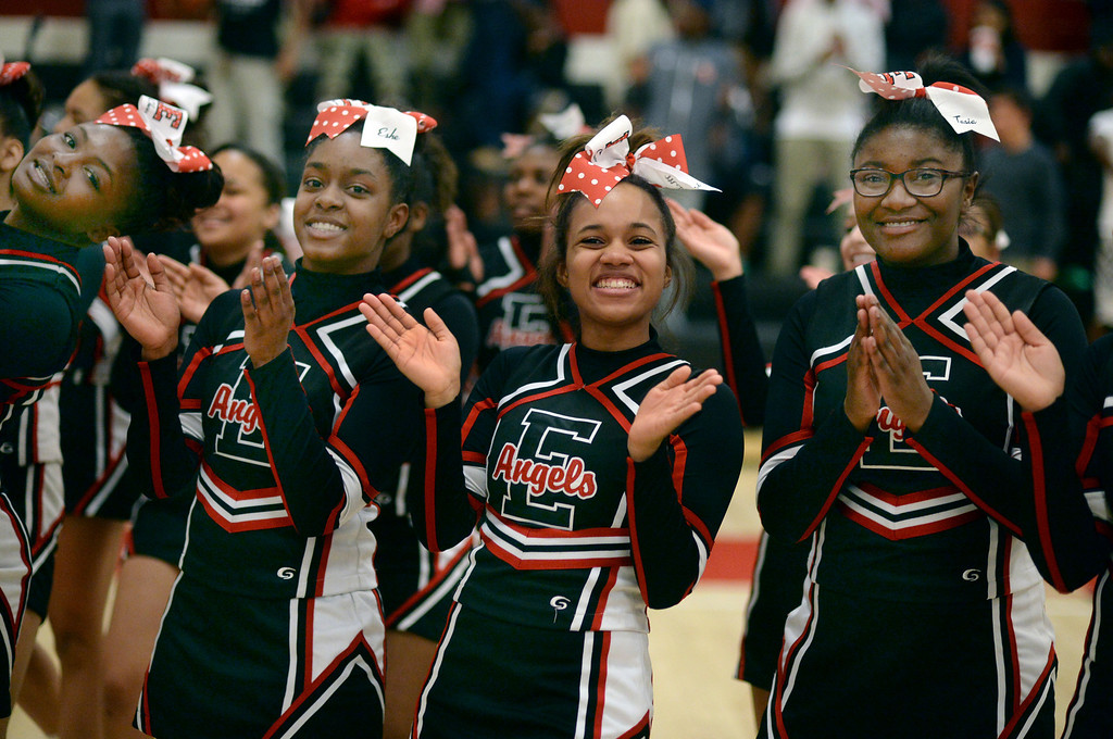 . East cheerleaders celebrated the win Friday night. The Denver East High School girl\'s basketball team defeated Fairview 68-53 Friday night, February 28, 2014. Photo By Karl Gehring/The Denver Post