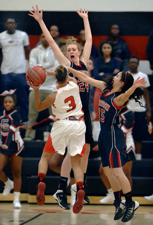 . East senior guard Michelle Cox (3) tried to get past Fairview defenders Kate Davenport (24) and Sarah Gordon (15) in the second half. The Denver East High School girl\'s basketball team defeated Fairview 68-53 Friday night, February 28, 2014. Photo By Karl Gehring/The Denver Post