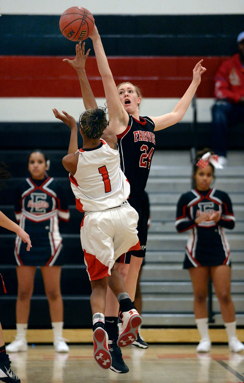 . Fairview center Kate Davenport (24) got a hand on a shot from East guard Ke\'Avae\' Taylor (1) in the second half. The Denver East High School girl\'s basketball team defeated Fairview 68-53 Friday night, February 28, 2014. Photo By Karl Gehring/The Denver Post