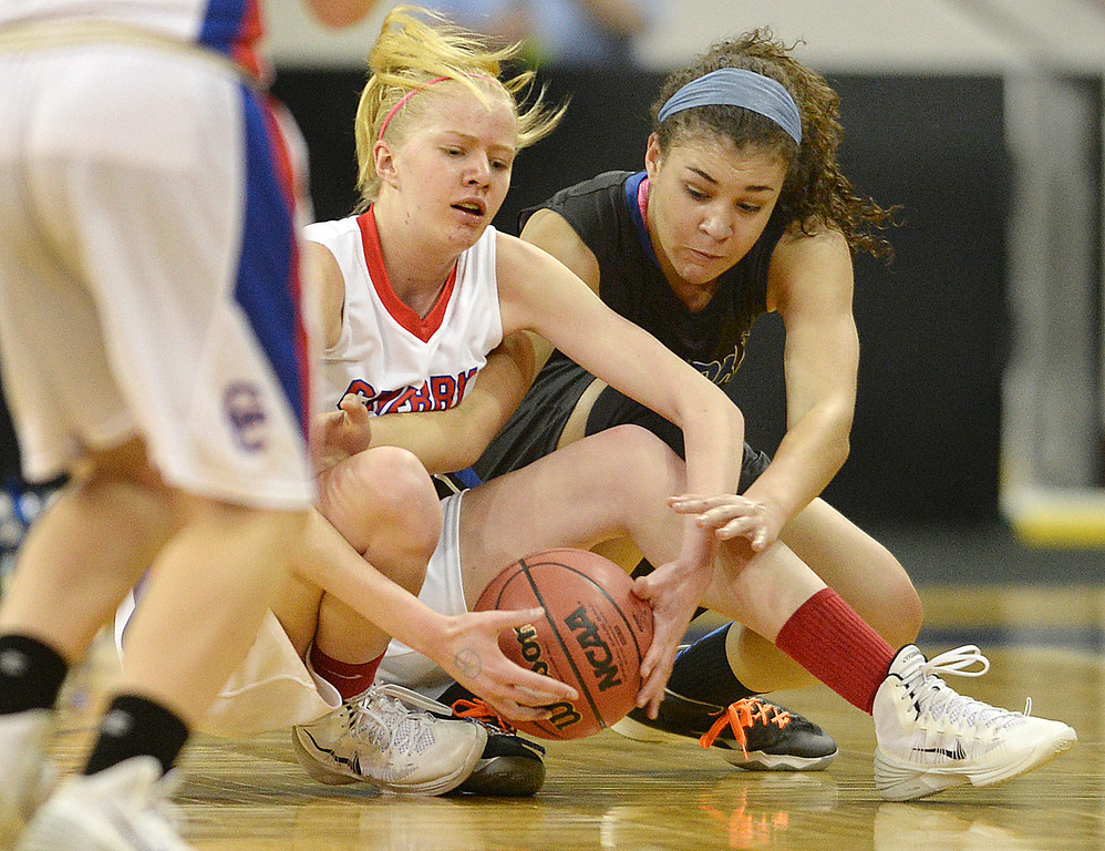 . Bruins freshman wing Laura Pranger (25) went to the floor with Poudre forward Myanne Hamm (21) for a loose ball in the first half. The Cherry Creek High School girl\'s basketball team met Poudre in a 5A playoff game Thursday night, March 5, 2014 at the Denver Coliseum. Photo By Karl Gehring/The Denver Post