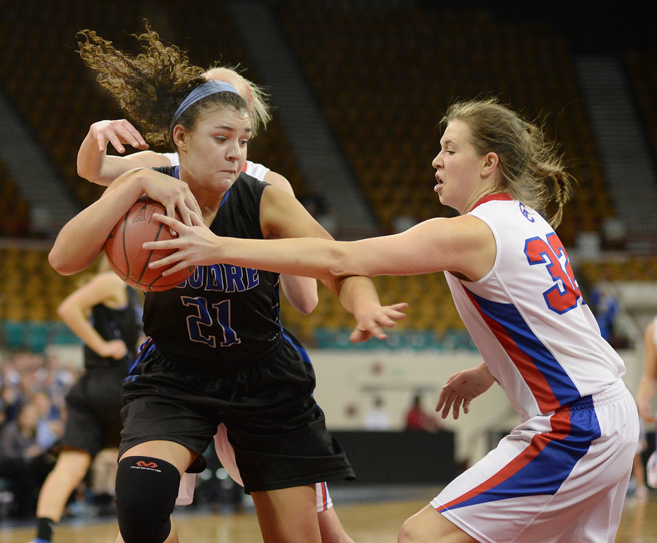 . Poudre forward Myanne Hamm (21) tried to keep the ball from Creek\'s Mikaela Eppard (32) in the second half. The Poudre High School girl\'s basketball team defeated Cherry Creek 47-38 in a 5A playoff game Thursday night, March 6, 2014 at the Denver Coliseum. Photo By Karl Gehring/The Denver Post