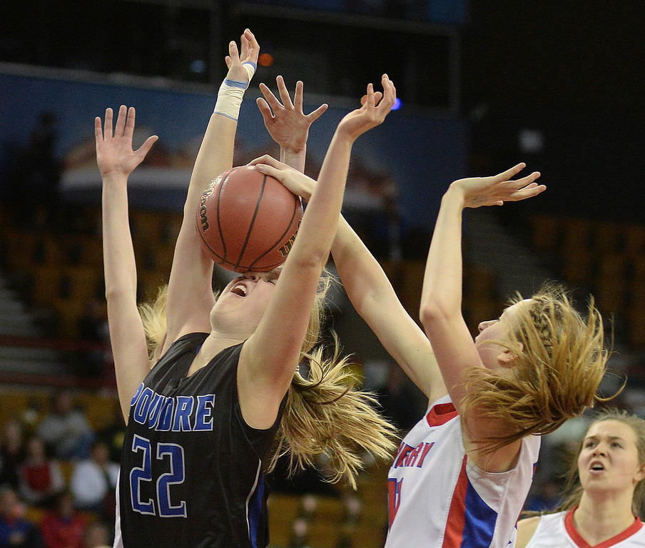 . Poudre guard Ashley McDaniel (22) took the ball in the face in the first quarter. The Cherry Creek High School girl\'s basketball team met Poudre in a 5A playoff game Thursday night, March 5, 2014 at the Denver Coliseum. Photo By Karl Gehring/The Denver Post