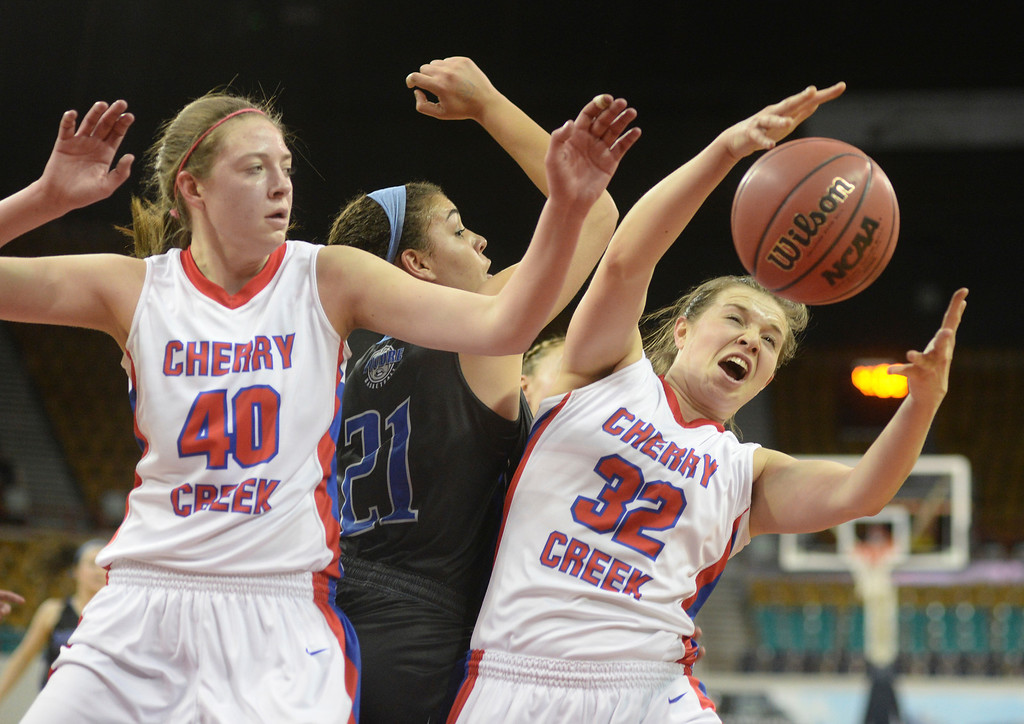. Bruins senior wing Mikaela Eppard (32) grabbed a rebound in the first half. The Cherry Creek High School girl\'s basketball team met Poudre in a 5A playoff game Thursday night, March 5, 2014 at the Denver Coliseum. Photo By Karl Gehring/The Denver Post