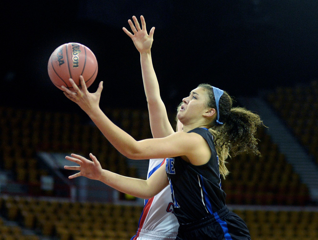 . Poudre forward Myanne Hamm (21) moved past Creek defender Lauren McMillen (11) in the first half. The Cherry Creek High School girl\'s basketball team met Poudre in a 5A playoff game Thursday night, March 5, 2014 at the Denver Coliseum. Photo By Karl Gehring/The Denver Post