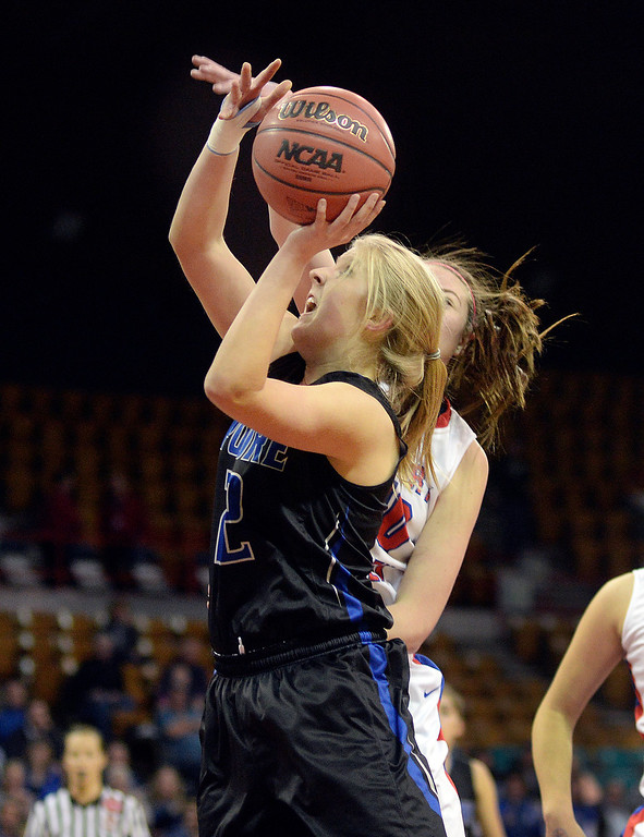 . Poudre guard Ashley McDaniel (22) made a move past Creek defender Molly Rohrer (40) in the first half. The Cherry Creek High School girl\'s basketball team met Poudre in a 5A playoff game Thursday night, March 5, 2014 at the Denver Coliseum. Photo By Karl Gehring/The Denver Post