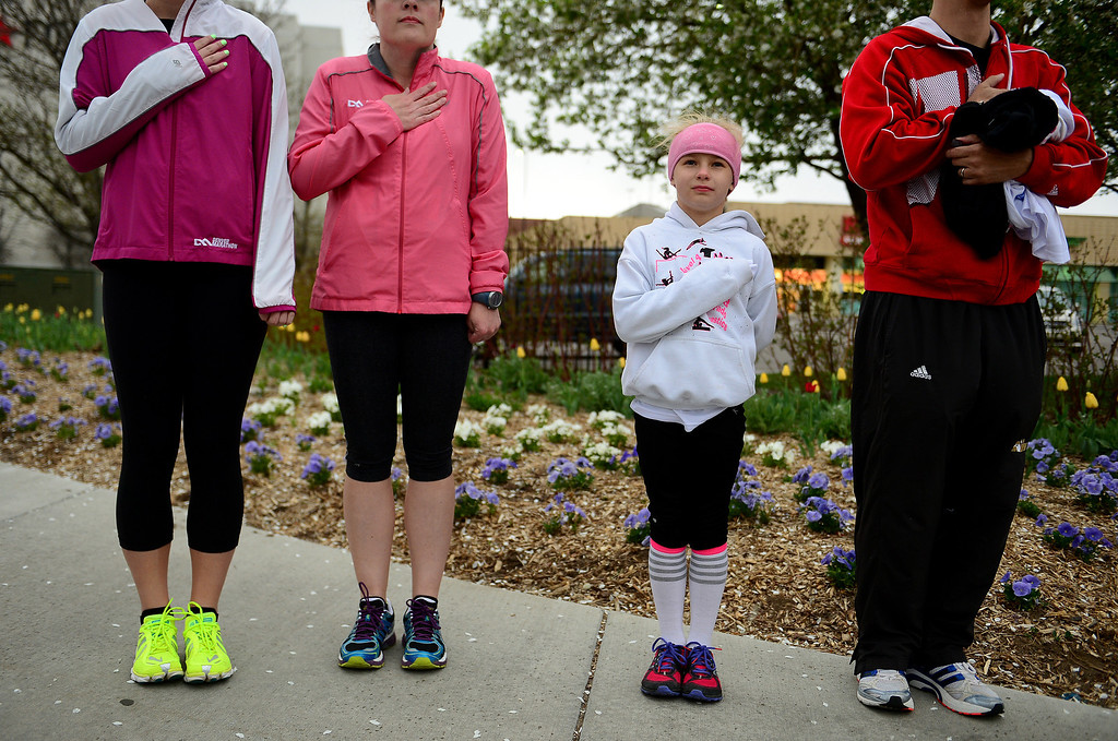 . Sunshine Habeck, 8, stands next to her father Josh, right, as they place their hands on their hearts during the singing of the national anthem before the start of the 32nd annual Cherry Creek Sneak. (Photo By Helen H. Richardson/ The Denver Post)
