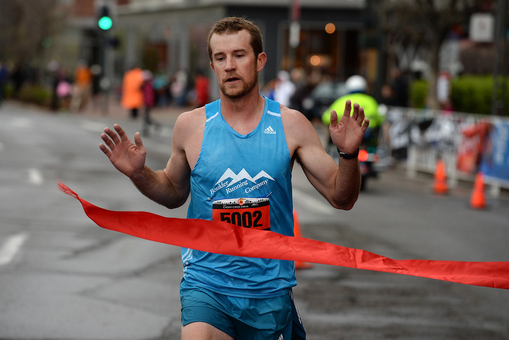 . Scott Dahlberg, with the Boulder Running Company, wins the 5-mile race during the 32nd annual Cherry Creek Sneak in Denver on April 27, 2014.  The race, which started and finished along East 1st Ave in Cherry Creek, included a 10 miler, a 5k and a 5-mile run.  (Photo By Helen H. Richardson/ The Denver Post)