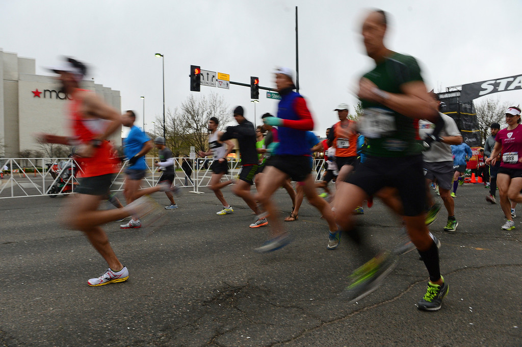 . Runners sprint from the starting line of the 32nd annual Cherry Creek Sneak.  (Photo By Helen H. Richardson/ The Denver Post)