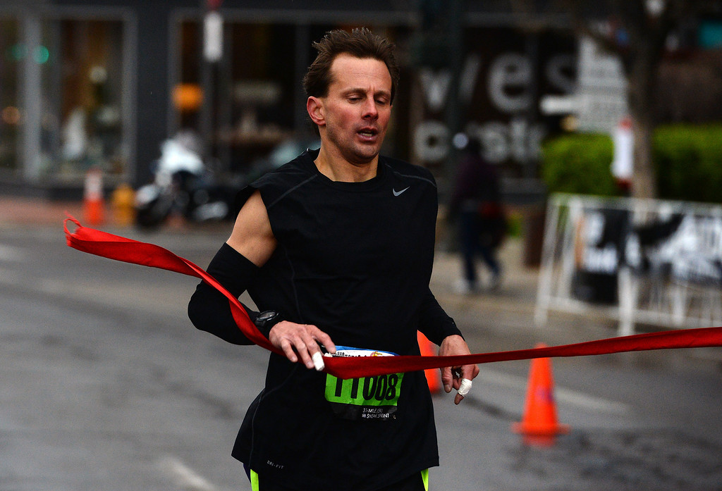 . Scott Siriano wins the 5k race during the 32nd annual Cherry Creek Sneak in Denver on April 27, 2014. The race, which started and finished along East 1st Ave in Cherry Creek, included a 10 miler, a 5k and a 5-mile run.  (Photo By Helen H. Richardson/ The Denver Post)