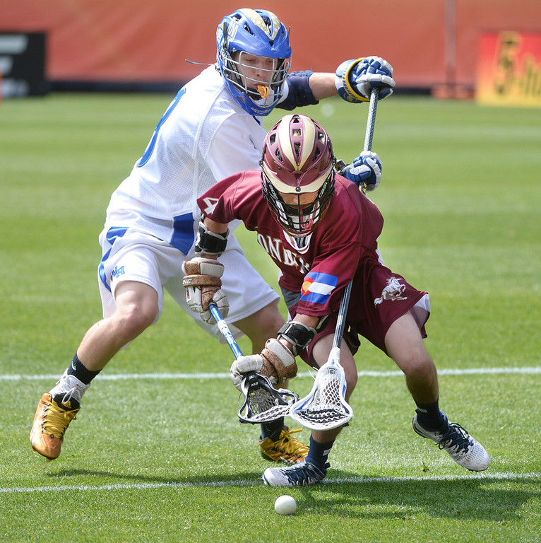 . Wheat Ridge long stick Cody Bartusiak (8) battled for the ball with Ponderosa senior attack Kenny Schrader (4) in the second half. Ponderosa High School boy\'s lacrosse team defeated Wheat Ridge 13-11 in the 4A championship game Saturday afternoon, May 17, 2014. (Photo by Karl Gehring/The Denver Post)