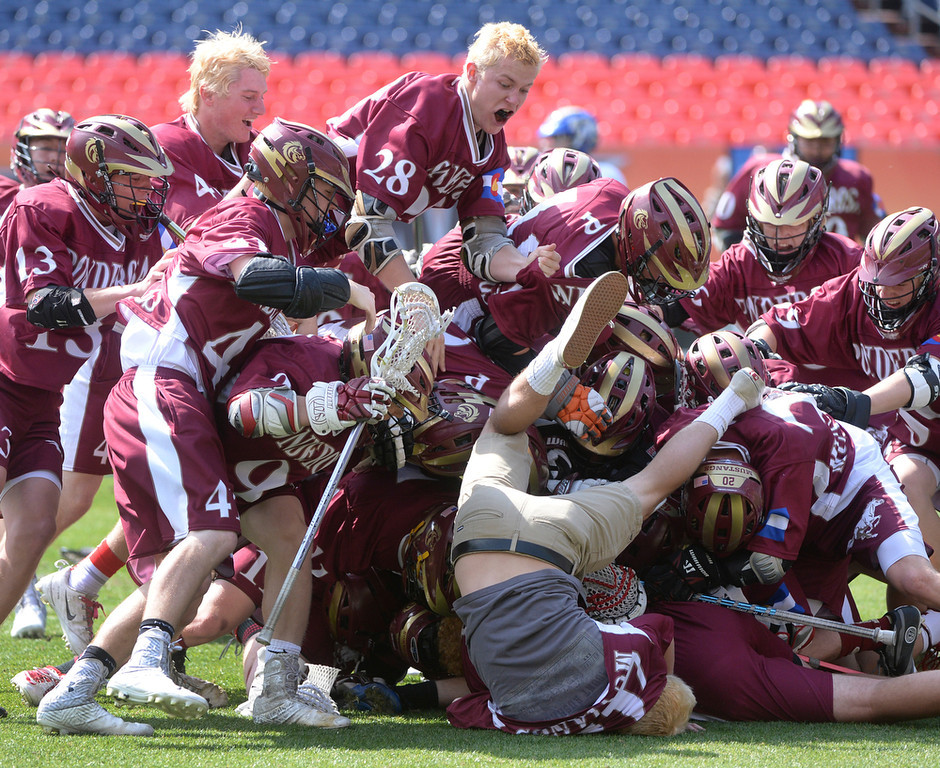 . The Mustangs gathered at midfield to start the celebration Saturday. Ponderosa High School boy\'s lacrosse team defeated Wheat Ridge 13-11 in the 4A championship game Saturday afternoon, May 17, 2014. (Photo by Karl Gehring/The Denver Post)