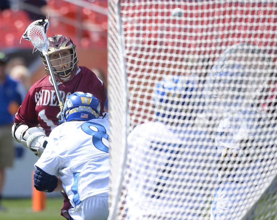 . Junior attack Derik Mango (12) put a shot on net in the second half Saturday. The Ponderosa High School boy\'s lacrosse team defeated Wheat Ridge 13-11 in the 4A championship game Saturday afternoon, May 17, 2014. (Photo by Karl Gehring/The Denver Post)