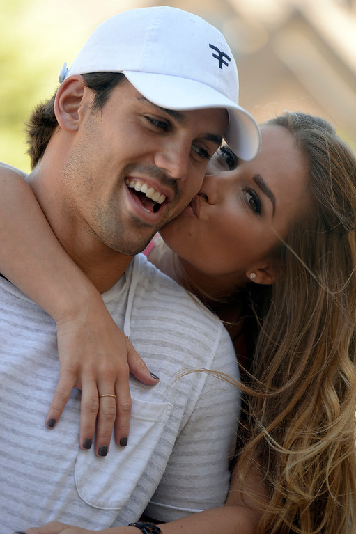 . CASTLE ROCK, CO. - JULY 17: Denver Broncos Eric Decker gets a kiss on the cheek from his wife Jessie James at their home July 17, 2013. Profile story on the wide receiver. (Photo By John Leyba/The Denver Post)