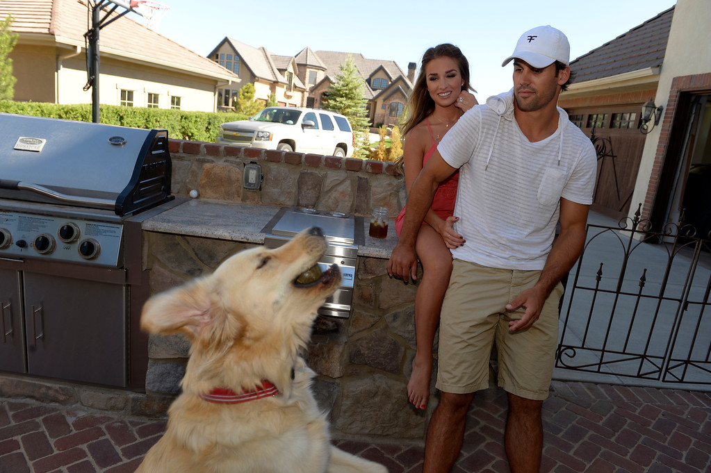 . CASTLE ROCK, CO. - JULY 17: Denver Broncos Eric Decker and his wife Jessie James watch Jake catch a  tennis ball at their home July 17, 2013. Profile story on the wide receiver. (Photo By John Leyba/The Denver Post)