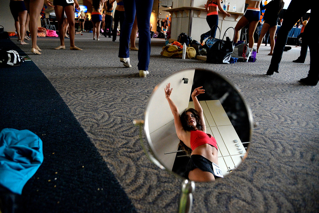 . Asheligh Miller of Des Moines, Iowa warms up during tryouts for the 2014-2015 Denver Broncos cheerleaders. More than 100 women showed up and 57 finalists were selected for the 26 spots on the team at Sports Authority Field at Mile High on Sunday, March 30. (Photo By AAron Ontiveroz/The Denver Post)