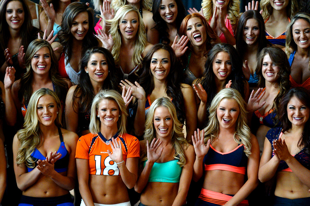 . Members of the final 57 women selected wave to a television camera during tryouts for the 2014-2015 Denver Broncos cheerleaders. More than 100 women showed up and 57 finalists were selected for the 26 spots on the team at Sports Authority Field at Mile High on Sunday, March 30. (Photo By AAron Ontiveroz/The Denver Post)