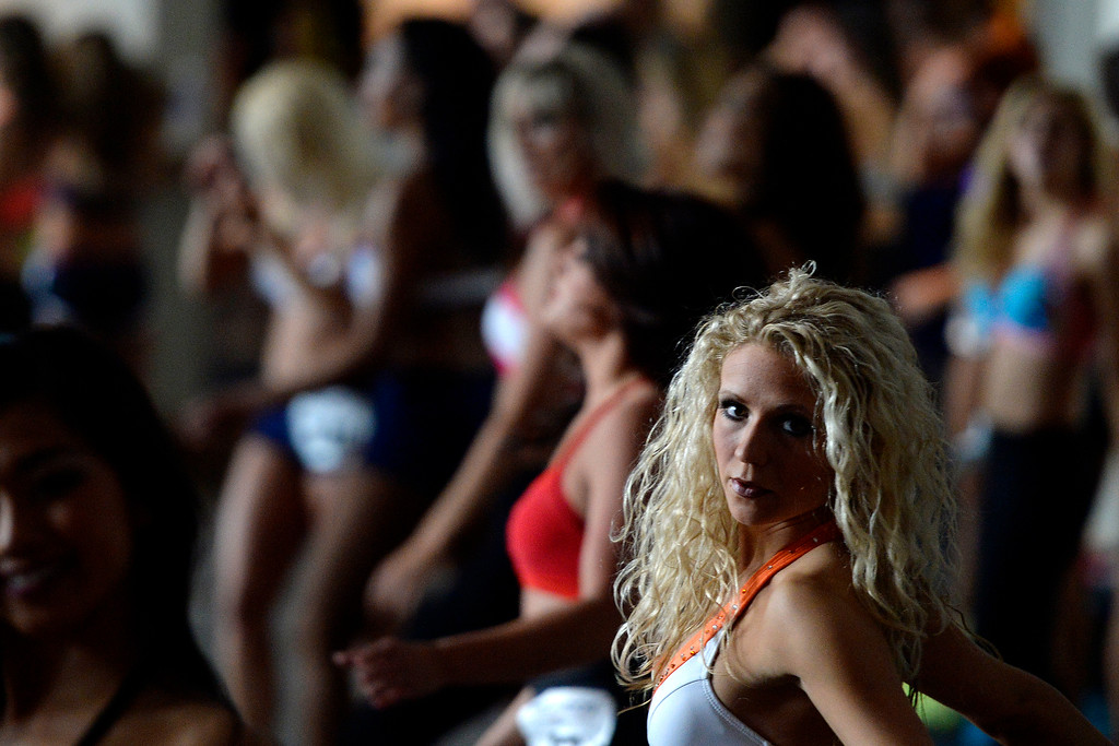 . Toni Gabrielli of Minnesota warms up during tryouts for the 2014-2015 Denver Broncos cheerleaders. More than 100 women showed up and 57 finalists were selected for the 26 spots on the team at Sports Authority Field at Mile High on Sunday, March 30. (Photo By AAron Ontiveroz/The Denver Post)