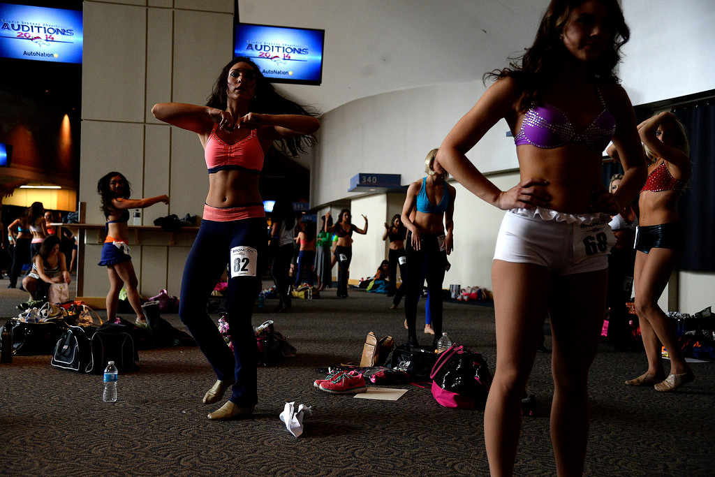 . Kayleigh Orr of Denver warms up during tryouts for the 2014-2015 Denver Broncos cheerleaders. More than 100 women showed up and 57 finalists were selected for the 26 spots on the team at Sports Authority Field at Mile High on Sunday, March 30. (Photo By AAron Ontiveroz/The Denver Post)