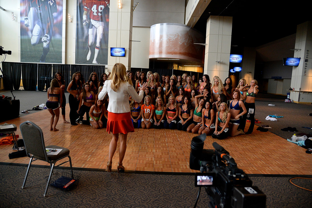 . The finalists prepare to take a group photo during tryouts for the 2014-2015 Denver Broncos cheerleaders. More than 100 women showed up and 57 finalists were selected for the 26 spots on the team at Sports Authority Field at Mile High on Sunday, March 30. (Photo By AAron Ontiveroz/The Denver Post)