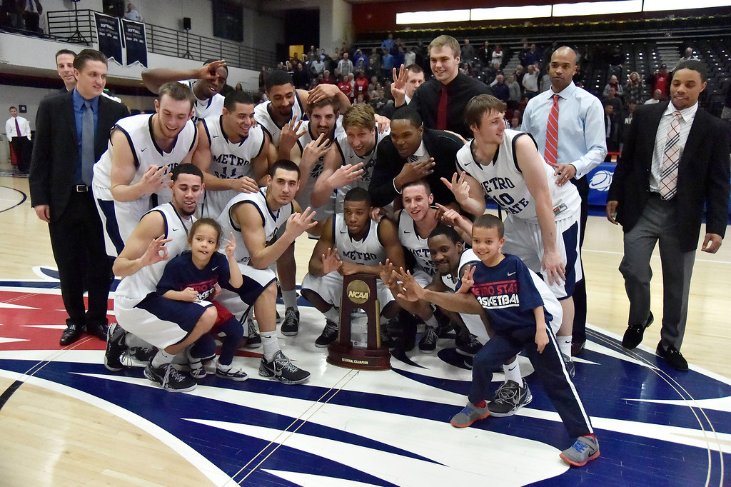 . Metro State celebrates their victory over Midwestern State 78-56 March 18, 2014 in the Championship game of the Division ll Men\'s Basketball Championship at Auraria Events Center. (Photo by John Leyba/The Denver Post)