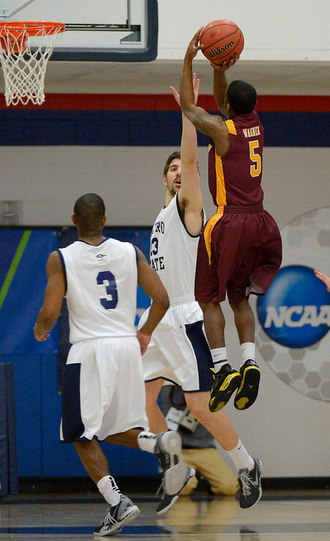 . Midwestern State Kevin Wagner (5) takes a shot over Metro State Harrison Goodrick (23) during the first half March 18, 2014 in the Championship game of the Division ll Men\'s Basketball Championship at Auraria Events Center. (Photo by John Leyba/The Denver Post)