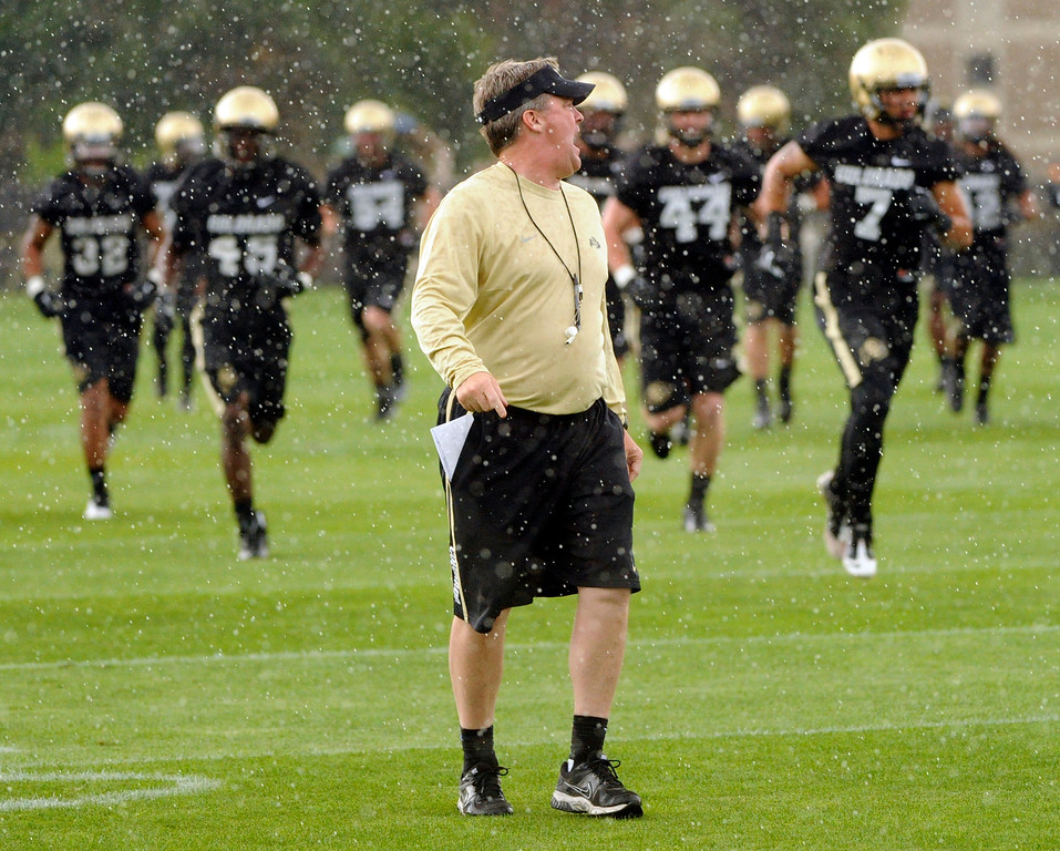 . BOULDER, CO. - AUGUST 06: Buffs head coach Mike MacIntyre put the practice on pause as heavy rain fell over Boulder Tuesday afternoon. The University of Colorado football team practiced for the first time Tuesday afternoon, August 6, 2013. Photo By Karl Gehring/The Denver Post