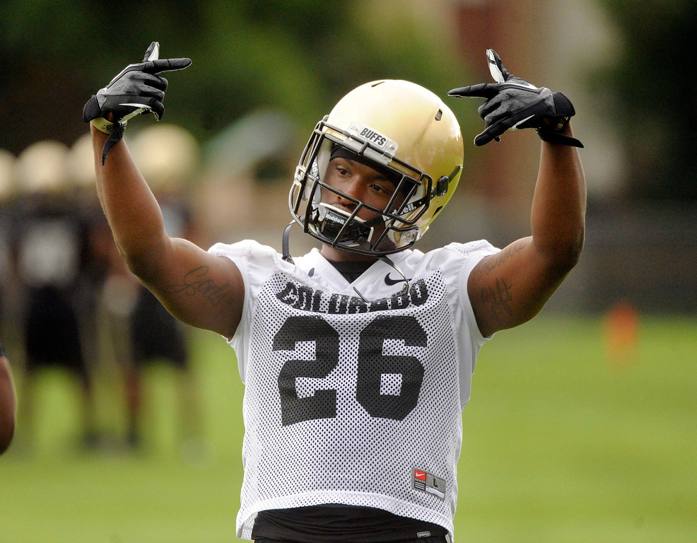 . BOULDER, CO. - AUGUST 06: Tailback Tony Jones enjoyed the music played before practice Tuesday. The University of Colorado football team practiced for the first time Tuesday afternoon, August 6, 2013. Photo By Karl Gehring/The Denver Post