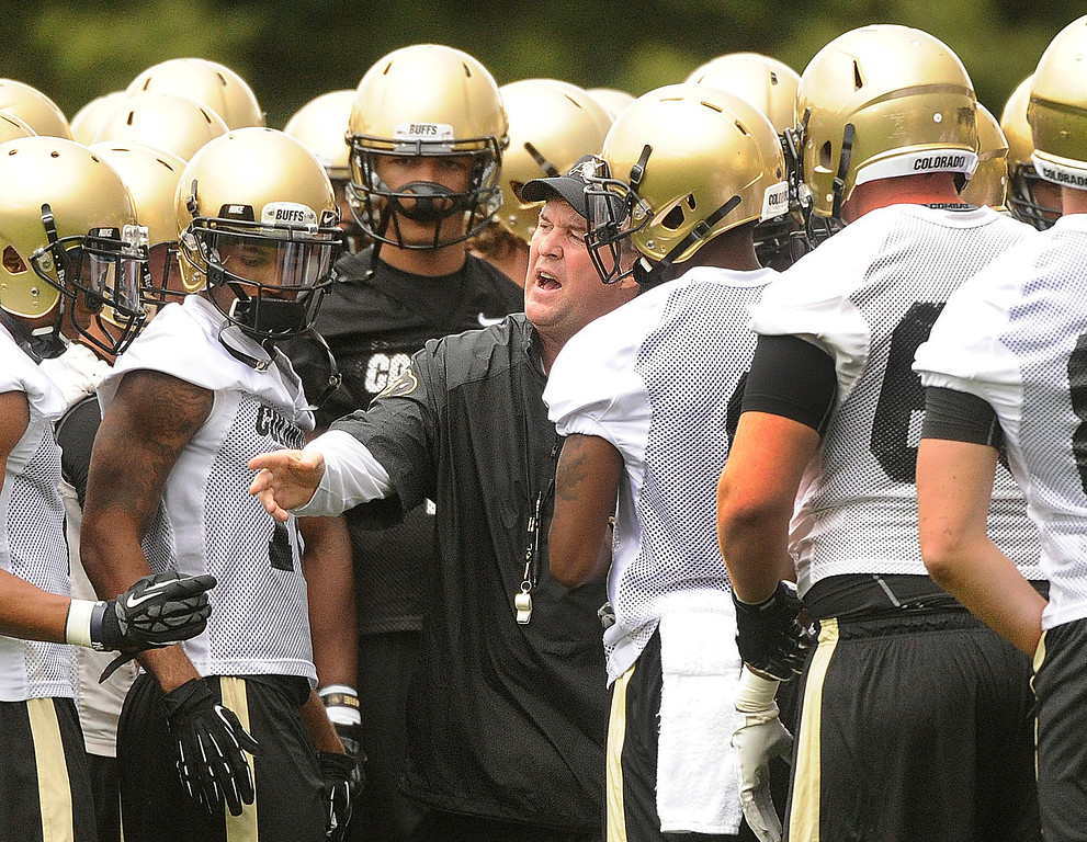 . BOULDER, CO. - AUGUST 06: Buffs head coach Mike MacIntyre brought the squad together during practice Tuesday. The University of Colorado football team practiced for the first time Tuesday afternoon, August 6, 2013. Photo By Karl Gehring/The Denver Post