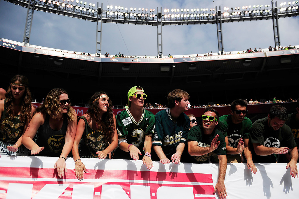 . Colorado State Rams fans cheer against the Colorado Buffaloes during the first half of the Rocky Mountain Showdown at Sports Authority Field at Mile High on Sunday, September 1, 2013. CU leads the all-time series. (Photo by AAron Ontiveroz/The Denver Post)
