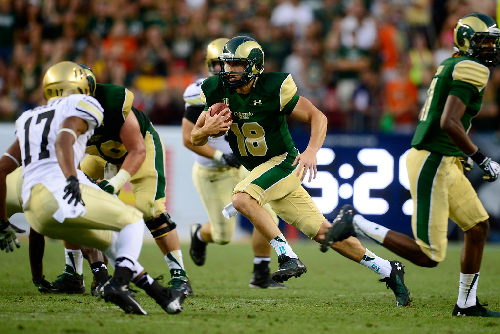 . Garrett Grayson (18) of the Colorado State Rams scrambles against the Colorado Buffaloes during the second half of the Buffaloes\' 41-27 Rocky Mountain Showdown win at Sports Authority Field at Mile High on Sunday, September 1, 2013. CU leads the all-time series. (Photo by AAron Ontiveroz/The Denver Post)