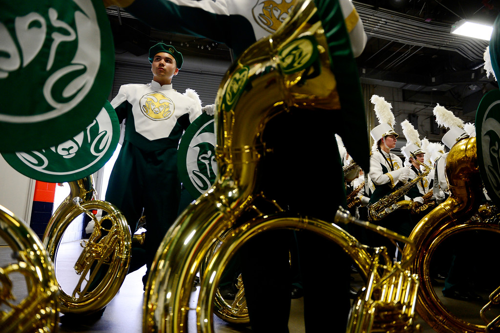 . Lane Todd stands in the tunnel with the rest of the CSU band before the first half of the Rocky Mountain Showdown at Sports Authority Field at Mile High on Sunday, September 1, 2013. CU leads the all-time series. (Photo by AAron Ontiveroz/The Denver Post)