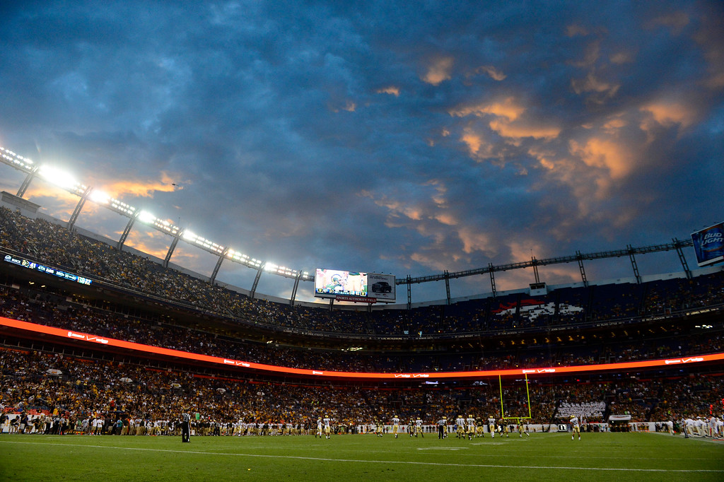 . The sun sets during the second half of the Buffaloes\' 41-27 Rocky Mountain Showdown win at Sports Authority Field at Mile High on Sunday, September 1, 2013. CU leads the all-time series. (Photo by AAron Ontiveroz/The Denver Post)