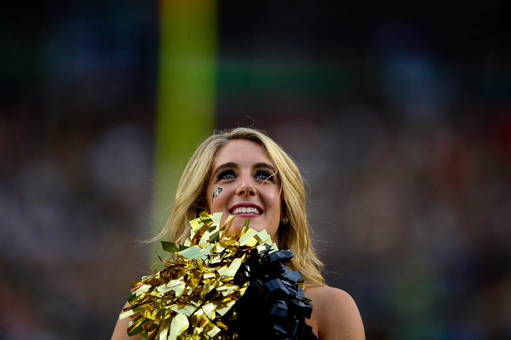 . A Colorado Buffaloes cheerleader leads the crowd against the Colorado State Rams during the second half of the Buffaloes\' 41-27 Rocky Mountain Showdown win at Sports Authority Field at Mile High on Sunday, September 1, 2013. CU leads the all-time series. (Photo by AAron Ontiveroz/The Denver Post)