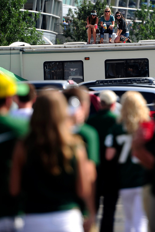 . Colorado State Rams fans sit atop an RV before the first half of the Rocky Mountain Showdown at Sports Authority Field at Mile High on Sunday, September 1, 2013. CU leads the all-time series. (Photo by AAron Ontiveroz/The Denver Post)