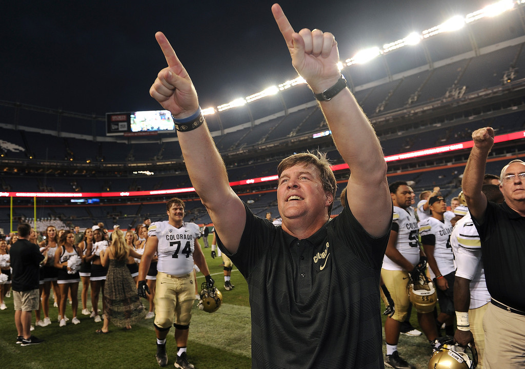 . CU head coach Mike MacIntyre points to fans in the stands after a victory over the CSU Rams ine the Rocky Mountain Showdown at Sports Authority Field at Mile High on Sunday, September 1, 2013. Despite CSU\'s effort in the final minutes,  CU beat CSU 41 to 27.  Photo by Helen H. Richardson/The Denver Post