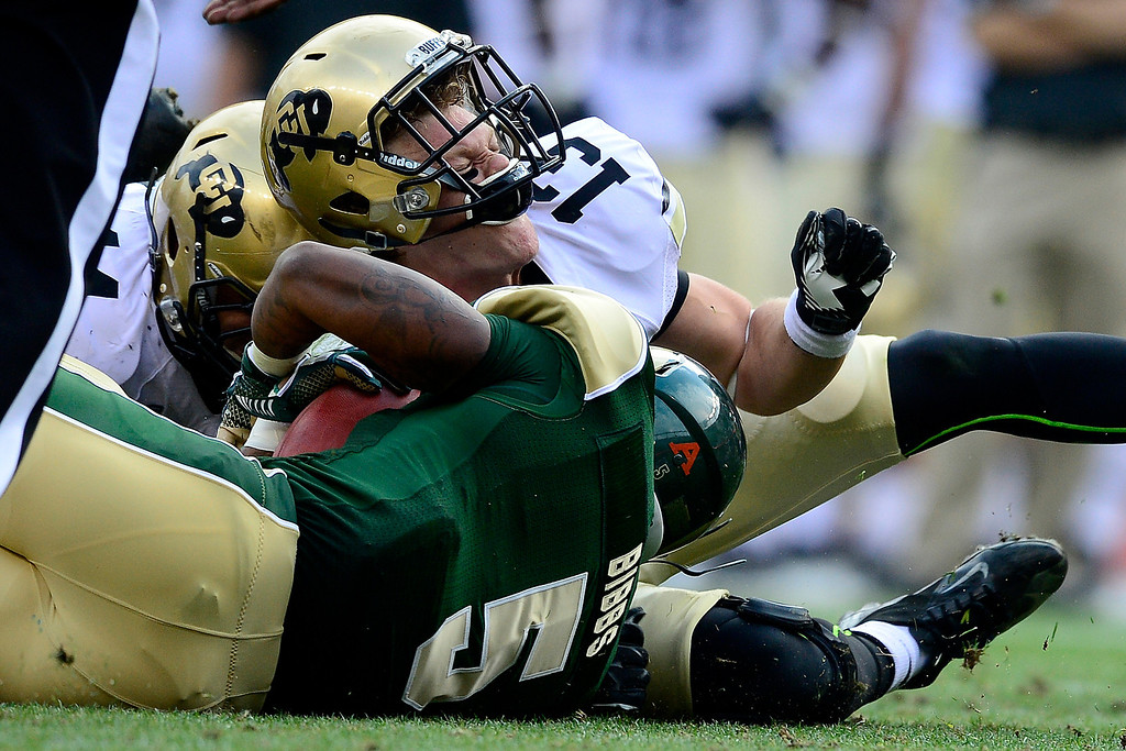 . Parker Orms (13) of the Colorado Buffaloes tackles Kapri Bibbs (5) of the Colorado State Rams during the first half of the Rocky Mountain Showdown at Sports Authority Field at Mile High on Sunday, September 1, 2013. CU leads the all-time series. (Photo by AAron Ontiveroz/The Denver Post)